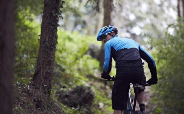 Mountain biker riding and looking behind